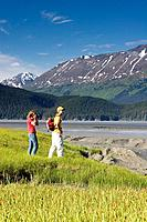 Young Couple Hiking Meadow near Bird Pt Turnagain Arm AK SC Summer