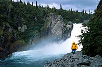 Hiker in Raingear Tazimina Falls Southwest AK Summer