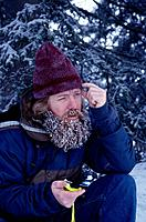 Man Lost In Wilderness Using Compass Frozen Beard