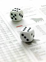 Dice on financial newspaper