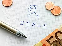 Hangman game on paper with Euro money