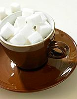 Espresso cup filled with sugar cubes