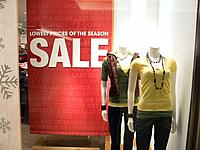 Mannekins in store window, clothing sale