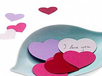 Bowl of paper hearts with I love you message