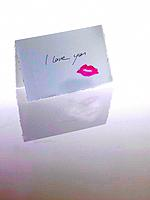 Love letter with I love you and lipstick kiss