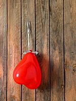 Red heart shaped balloon hanging on wall