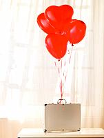 Briefcase with heart shaped balloons