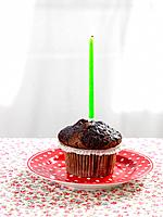 Chocolate cupcake with lit candle
