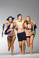 Young adults with snorkeling gear, studio shot