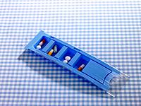 Close_up of pills and capsules in a blister pack