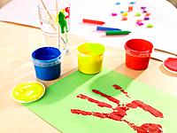 Close_up of a handprint with watercolor paints