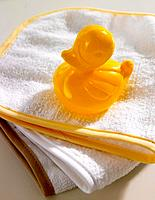 Close_up of a rubber duck on towels