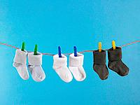 Close-up of baby socks hanging on a clothesline (thumbnail)