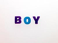 Word BOY made from magnetic letters