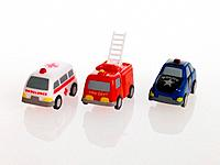 Close_up of a toy ambulance with a fire engine and a police car