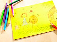 Close_up of a child´s drawing on a sheet of paper depicting a family