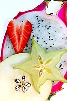 Slices of dragon fruit, strawberry, starfruit, and pear