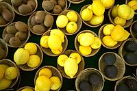 Kiwis Lemons and Limes in Small Baskets