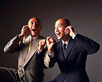Two bald headed businessmen excited and talking on mobile phones, Side View
