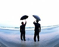 Image of Two Businessmen Holding an Umbrella In the Air, Looking at the Sea, Rear View, Fish Eye