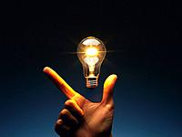 Light bulb floating above fingers, Front View