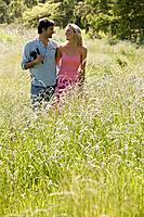 A couple walking through long grass