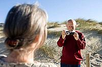 Senior couple photographing at beach