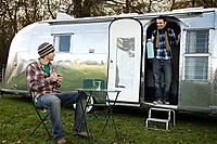 Two teenage boys and a caravan