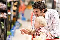 Father and child in supermarket