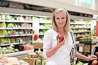 Woman in supermarket with mango