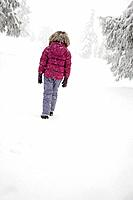 Girl walking in the snow