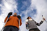 A mature couple skiing