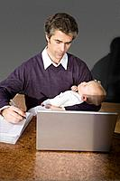 A father holding his son and working (thumbnail)