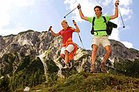 Austria, Salzburger Land, couple cutting a caper