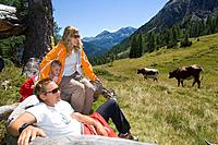 Austria, Salzburger Land, couple with daughter taking a break
