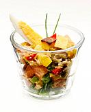 Salad with tuna, anchovies and vegetable in glass, close_up