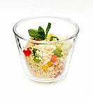 Couscous salad with vegetable in glass