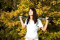 Brunette woman doing Nordic Walking