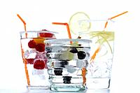 Drinks and fruits in glasses with sweetened rim