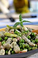 Broad beans and peas with green or spring garlics