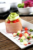 Melon and watermelon cubes with swordfish and wild green asparagus