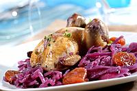 Partridges stewed with red cabbage