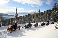 Snowmobiling group on tour at Silver Star Mountain Resort, Vernon, British Columbia, Canada.