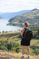 Female hiker overlooking Kalamalka Lake, Vernon, British Columbia, Canada.