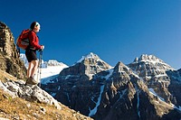 A female hiker above Moraine Lake and the Valley of the Ten Peaks en route to Sentinel Pass, Alberta, Canada.