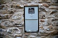 Electric meter in stone wall