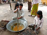 Cambodia  Siem Reap  Family making palm sugar candy