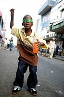 Dancing boy on Frederick Street during Carnival celebrations, Port of Spain, Island of Trinidad, Republic of Trinidad and Tobago