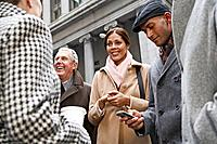Businesspeople Standing on Sidewalk