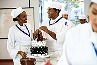 African pastry chefs decorating cakes